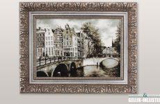 Amsterdams stadsgezicht in een barok lijst